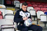 AFC Wimbledon midfielder Dean Parrett (18) autographing ball during the EFL Sky Bet League 1 match between AFC Wimbledon and Wigan Athletic at the Cherry Red Records Stadium, Kingston, England on 16 December 2017. Photo by Matthew Redman.