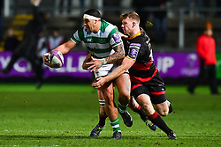 Newcastle Falcons' Josh Matavesi is tackled by Dragons' Jack Dixon<br /> <br /> Photographer Craig Thomas/Replay Images<br /> <br /> EPCR Champions Cup Round 3 - Newport Gwent Dragons v Newcastle Falcons - Saturday 15th December 2017 - Rodney Parade - Newport<br /> <br /> World Copyright © 2017 Replay Images. All rights reserved. info@replayimages.co.uk - www.replayimages.co.uk
