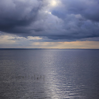 """""""All that Shimmers""""<br /> <br /> Stormy skies just after sunrise on Lake Huron. Shimmering white sunlight reflects across the waters!<br /> <br /> Sunrise Images by Rachel Cohen"""