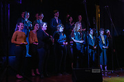The Baden St Singers, including singing wine glasses, at the 2019 Guildford Songfest