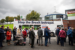 "© Licensed to London News Pictures . 22/09/2018. Bolton, UK. People queue by the Stop the Brexit betrayal Believe in Britain bus outside the stadium . Pro Brexit campaign group Leave Means Leave host a "" Save Brexit "" and "" Chuck Chequers "" rally at the University of Bolton Stadium , attended by leave-supporting politicians from a cross section of parties , including Conservative David Davis , former UKIP leader Nigel Farage and Labour's Kate Hoey . Photo credit: Joel Goodman/LNP"