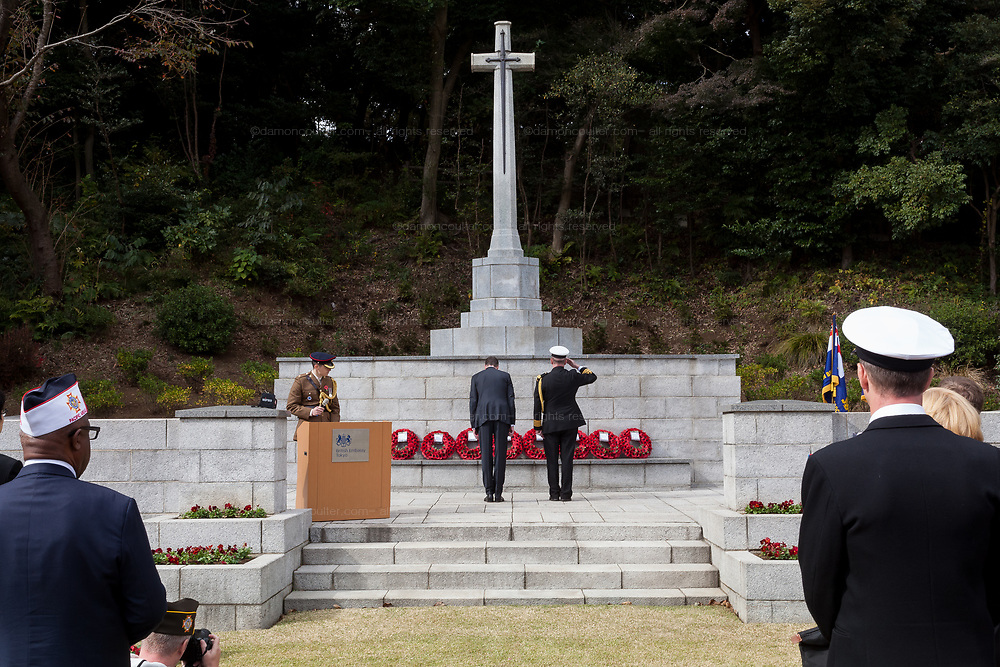 Canadian Ambassador,  Ian Burney and a Canadian military officer lay a wreath of poppies at the Cross of Sacrific during the Remembrance Sunday ceremony at the Hodogaya, Commonwealth War Graves Cemetery in Hodogaya, Yokohama, Kanagawa, Japan. Sunday November 12th 2017. The Hodagaya Cemetery holds the remains of more than 1500 servicemen and women, from the Commonwealth but also from Holland and the United States, who died as prisoners of war or during the Allied occupation of Japan. Each year officials from the British and Commonwealth embassies, the British Legion and the British Chamber of Commerce honour the dead at a ceremony in this beautiful cemetery.