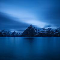 Clouds drift over the summit of Olstind mountain peak, Hamnøy, Moskenesøy, Lofoten Islands, Norway