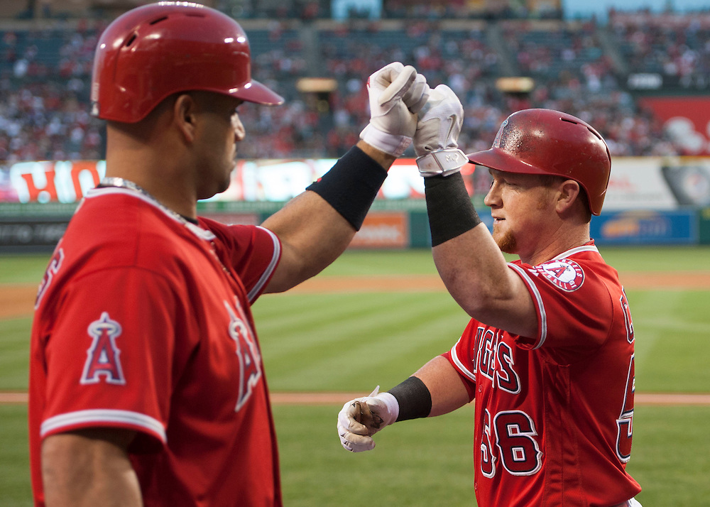 The Angels' Kole Calhoun celebrates with Albert Pujols after his solo home run in the third inning against the Minnesota Twins Tuesday night at Angel Stadium.<br /> <br /> ///ADDITIONAL INFO:   <br /> <br /> angels.0615.kjs  ---  Photo by KEVIN SULLIVAN / Orange County Register  -- 6/14/16<br /> <br /> The Los Angeles Angels take on the Minnesota Twins Tuesday at Angel Stadium.