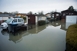 © Licensed to London News Pictures. 03/02/2021. Laleham, UK. Residential properties flooded in Laleham, Surrey where water levels along the Thames have risen. Large parts of the UK experience more wet conditions which is expected to bring further flooding. Photo credit: Ben Cawthra/LNP