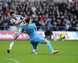 Swansea City's Alejandro Pozuelo battles for the ball with Tottenham Hotspur's Vlad Chiriches - Photo mandatory by-line: Joe Meredith/JMP - Tel: Mobile: 07966 386802 19/01/2014 - SPORT - FOOTBALL - Liberty Stadium - Swansea - Swansea City v Tottenham Hotspur - Barclays Premier League
