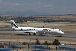 © Licensed to London News Pictures. 15/06/2012. Madird.  A Swiftair MD83 taken June 2012 at Madrid Barajas airport. The aircraft is the same type and airline as the Algeria plane reported missing today 24th July 2014. Flight AH5017 had 110 passengers and six crew on board, including as many as 50 French citizens.  Photo credit : Jim Preston/LNP