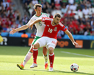 Sam Vokes of Wales shields the ball from Jonny Evans of Northern Ireland. UEFA Euro 2016, last 16 , Wales v Northern Ireland at the Parc des Princes in Paris, France on Saturday 25th June 2016, pic by  Andrew Orchard, Andrew Orchard sports photography.