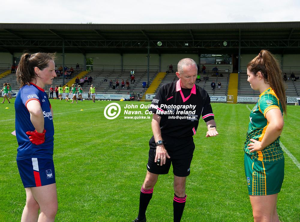 10-07-21. Meath v Cork - LGFA All-Ireland Senior Championship - Group 3 Round 1 at St. Brendan's Park, Birr.<br /> Referee John Devlin shows the coin following the toss to Cork team captain Martina O'Brien and Meath team captain Shauna Ennis.<br /> Photo: John Quirke / www.quirke.ie<br /> ©John Quirke Photography, 16 Proudstown Road, Navan. Co. Meath. (info@quirke.ie / 046-9028461 / 087-2579454).