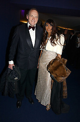 The EARL OF DARTMOUTH and MALA LINDSAY at the British Red Cross London Ball held at The Room by The River, 99 Upper Ground, London SE1 on 16th November 2006.<br />