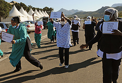 South Africa - Cape Town - 19 June 2020 - Coronavirus Lockdown 3 - Nurses held a lunchtime picket at False Bay Hospital on Friday. The purpose of the Denosa picket was to demand PPE's and other work benefits for staff, such as filling staff vacancies and to demand proper decontamination. Picture: Tracey Adams/African News Agency(ANA)