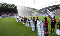 Football - 2017 / 2018 Premier League - Huddersfield Town vs. Newcastle United<br /> <br /> Kids get soaked by a sprinkler at The John Smith Stadium.<br /> <br /> COLORSPORT/LYNNE CAMERON