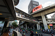 A large LED screen projects a surreal moment over the Sala Daeng intersection