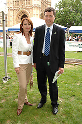 Presenter KAY BURLEY and Chief Executive of Macmillan Cancer Support CIARAN DEVANE at the 20th annual House of Lords v House of Commons Tug of War in aid of Macmillan Cancer Support held on Abingdon Green, Westminster, London on 13th June 2007.<br /><br />NON EXCLUSIVE - WORLD RIGHTS