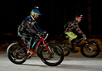 Alex Indeck and Tucker Nugent head out for the start of the Fatbike Fury race at Gunstock Nordic on Saturday evening.  (Karen Bobotas/for the Laconia Daily Sun)