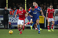 AFC Wimbledon defender Will Nightingale (5) battles for possession with Barnsley midfielder Kenny Dougall (4) during the EFL Sky Bet League 1 match between AFC Wimbledon and Barnsley at the Cherry Red Records Stadium, Kingston, England on 19 January 2019.