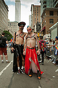 A couple bedecked in vinyl posing in the 2011 Pride Parade on New York's Fifth Avenue.