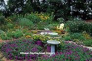 63821-14209 Flower garden with bird bath, Yellow Adirondack chair, Inuksuk, perennials & annuals  Marion Co. IL