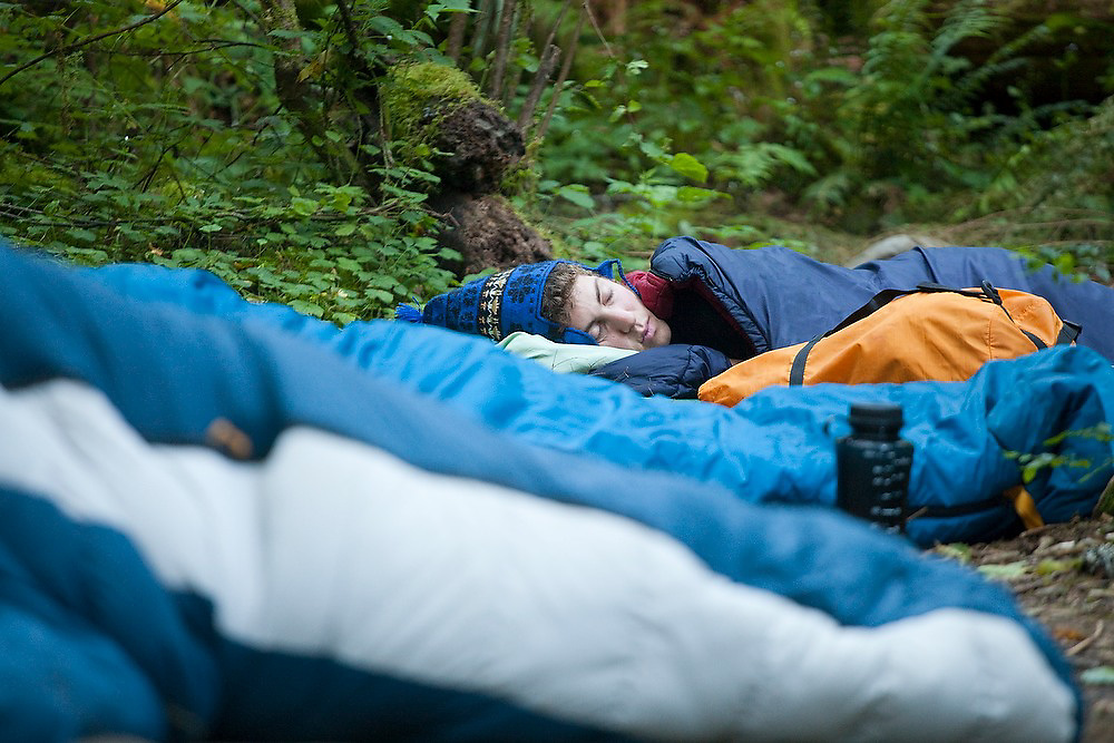 Zach Podell-Eberhardt sleeps soundly in his sleeping bag at Seven and a Half Mile Camp, along Eagle Creek Trail