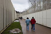 Visitors walk through the secure grounds of the prison. HMP Send, closed female prison. Ripley, Surrey.