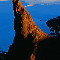 Gruvleflesa Spire glows in midnight sun in the Holtedahl Mountains, Queen Maud Land, Antarctica.