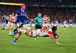Japan's Pieter Labuschagne scores his sides third try during the Pool A match between Japan and Russia at the Tokyo Stadium, Tokyo, Japan. Picture date: Friday September 20, 2019. See PA story RUGBYU Japan. Photo credit should read: Ashley Western/PA Wire. RESTRICTIONS: Editorial use only. Strictly no commercial use or association. Still image use only. Use implies acceptance of RWC 2019 T&Cs (in particular Section 5 of RWC 2019 T&Cs) at: https://bit.ly/2knOId6