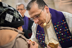 1 March 2020, Bethlehem: Rev. Munther Isaac distributes bread to a young boy during Holy Communion during Sunday service in the Evangelical Lutheran Christmas Church in Bethlehem.