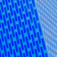 Dominos - Mesmerizing windows adorn this Gotham City building.