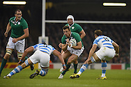 Ireland's Tommy Bowe runs at Argentina's Tomas Lavanini.  Rugby World Cup 2015 quarter-final match, Ireland v Argentina at the Millennium Stadium in Cardiff, South Wales  on Sunday 18th October 2015.<br /> pic by  Andrew Orchard, Andrew Orchard sports photography.