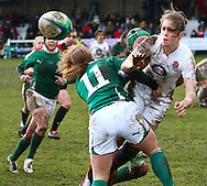 29 Feb 2010 Esher, Surrey: Emily Scarratt of England is tackled by Amy Davis (11) of Ireland during the Women's Six Nations game between England and Ireland at Esher Rugby Club (photo by Andrew Tobin/SLIK images)