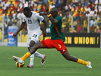 Photo: Steve Bond/Richard Lane Photography.<br />Ghana v Cameroon. Africa Cup of Nations. 07/02/2008. Thimothee Atouba (R) gets his foot to the ball in front of Haminu Draman (L)