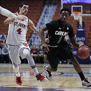 Marcus Stroman, (right), South Carolina, drives past Federico Mussini, St. John's, during the St. John's vs South Carolina Men's College Basketball game in the Hall of Fame Shootout Tournament at Mohegan Sun Arena, Uncasville, Connecticut, USA. 22nd December 2015. Photo Tim Clayton
