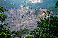 Indonesia, Java, Parompong. Tangkuban Prahu. Kawah Upas, the secondary crater, is behind this mountain ridge. Hot gases steams out of the mountain side.