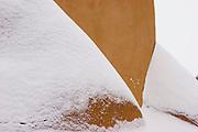 Close-up of buttresses in snow, St. Francis de Assisi Church, Ranchos de Taos, New Mexico