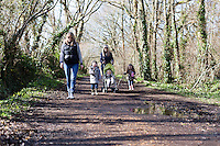 A family walk along the River Yar during Spring on the Isle of Wight