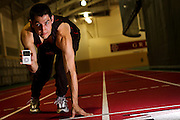Captain of the Men's Track and Field team Davis Hermann '11 poses with iPod in hand in the Bear Indoor Track on Thursday.