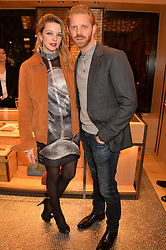 GRETA BELLAMACINA and ALISTAIR GUY at the opening party for Moynat's new Maison de Vente in Mayfair at 112 Mount Street, London W1 on 12th March 2014.