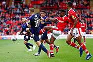 Luton Town forward James Collins (19) is fouled by Barnsley defender Dimitri Cavare (12)  during the EFL Sky Bet League 1 match between Barnsley and Luton Town at Oakwell, Barnsley, England on 13 October 2018.