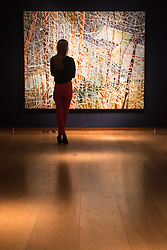 Christies, St James, London, February 5th 2016. A woman admires Peter Doig's The Architect's Home In The Ravine which has an estimated value of £10-15 million at the 20th Century Art Sale Preview. ///FOR LICENCING CONTACT: paul@pauldaveycreative.co.uk TEL:+44 (0) 7966 016 296 or +44 (0) 20 8969 6875. ©2015 Paul R Davey. All rights reserved.