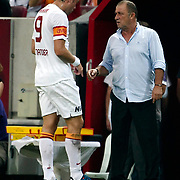 Galatasaray's Johan Elmander with coach Fatih Terim during their friendly soccer match Galatasaray between ACF Fiorentina at the TT Arena in istanbul Turkey on Wednesday 08 August 2012. Photo by TURKPIX