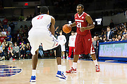 DALLAS, TX - NOVEMBER 25: Manuale Watkins #21 of the Arkansas Razorbacks brings the ball up court against the SMU Mustangs on November 25, 2014 at Moody Coliseum in Dallas, Texas.  (Photo by Cooper Neill/Getty Images) *** Local Caption *** Manuale Watkins