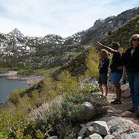 Hikers walk alongside Lake Sabrina in the Sierra Nevada above Bishop, California.