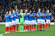 The players applaud in tribute to John Jenkins ahead of the EFL Sky Bet League 1 match between Portsmouth and Ipswich Town at Fratton Park, Portsmouth, England on 21 December 2019.