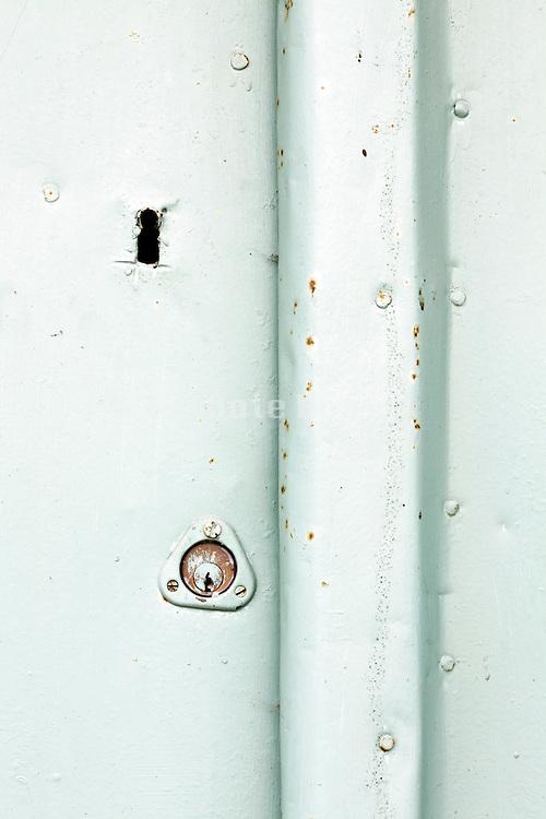 close up of locks in metal plated door