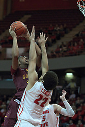 11 January 2014:  Christian Thomas struggles to get some height and a shot over Reggie Lynch during an NCAA  mens basketball game between the Ramblers of Loyola University and the Illinois State Redbirds  in Redbird Arena, Normal IL.  Redbirds win 59-50