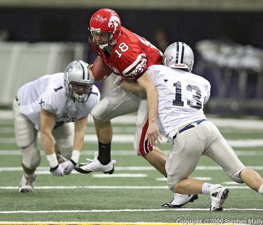 City High quarterback AJ Derby (18) his hit by Xavier linebacker Nick Garland (13) in their Class 4A semifinal game at the UNI Dome in Cedar Falls on Friday November 13, 2009.