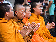 24 AUGUST 2015 - BANGKOK, THAILAND:  Buddhist monks presiding over a memorial service for victims of the Erawan Shrine bombing. One week after the a bomb at the Erawan Shrine in the center of Bangkok killed dozens and hospitalized scores of people, police have not made any arrests. Police bomb sniffing dogs have been deployed to malls and markets around Bangkok. There was a large memorial service sponsored by businesses close the bomb site Monday evening.   PHOTO BY JACK KURTZ