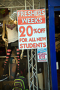Freshers Week discount shop prices offer poster in window, Hull, Yorkshire, England