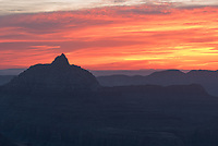 A vibrant sunrise glows in the east over Angels Gate as seen from Shoshoni Point.