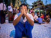 28 OCTOBER 2015 - YANGON, MYANMAR: A man prays at a statue of the Buddha during observances of Thadingyut at Botataung Pagoda in Yangon. Botataung Pagoda was first built by the Mon, a Burmese ethnic minority, around the same time as was Shwedagon Pagoda, over 2500 years ago. The Thadingyut Festival, the Lighting Festival of Myanmar, is held on the full moon day of the Burmese Lunar month of Thadingyut. As a custom, it is held at the end of the Buddhist lent (Vassa). The Thadingyut festival is the celebration to welcome the Buddha's descent from heaven.    PHOTO BY JACK KURTZ